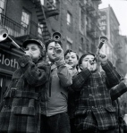 Blowing horns on Bleeker Street on New Year's Day